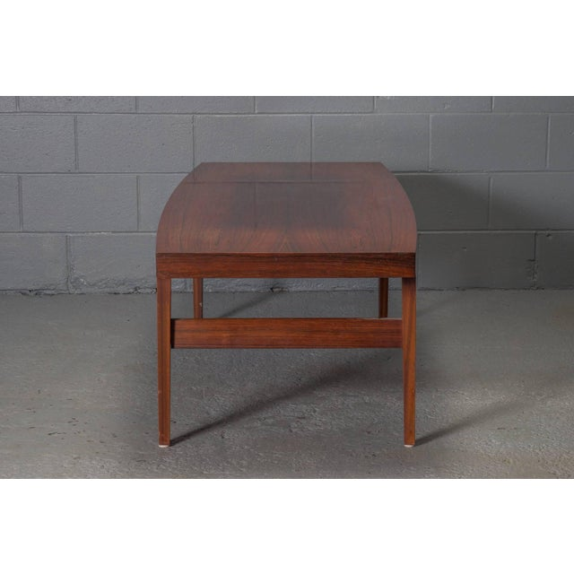 Mid-Century Danish Modern Rosewood Coffee Table. Slightly bowed shape.