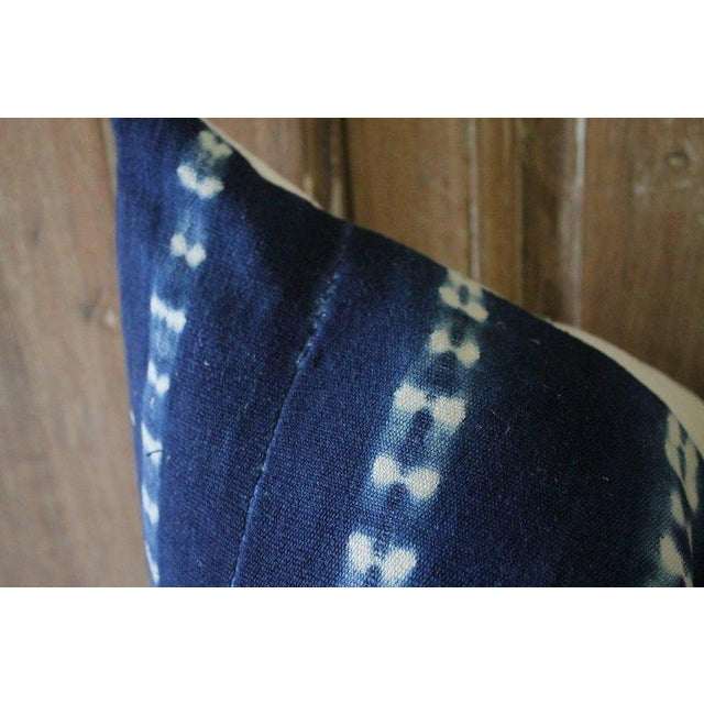 Antique indigo blue Batik accent pillows with fringe. Custom-made by Full Bloom Cottage, the fronts of the pillows are in...