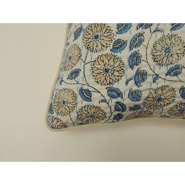 Indian quilted lotus in blue and yellow decorative pillow. Vintage floral hand quilted Indian pillow in yellow, blue and...