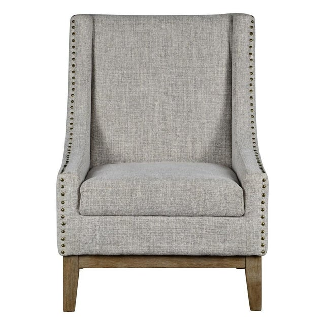 Jasmine Chair is a nice spin on a traditional wing chair. It has sleek wings and a weathered driftwood finish on the...