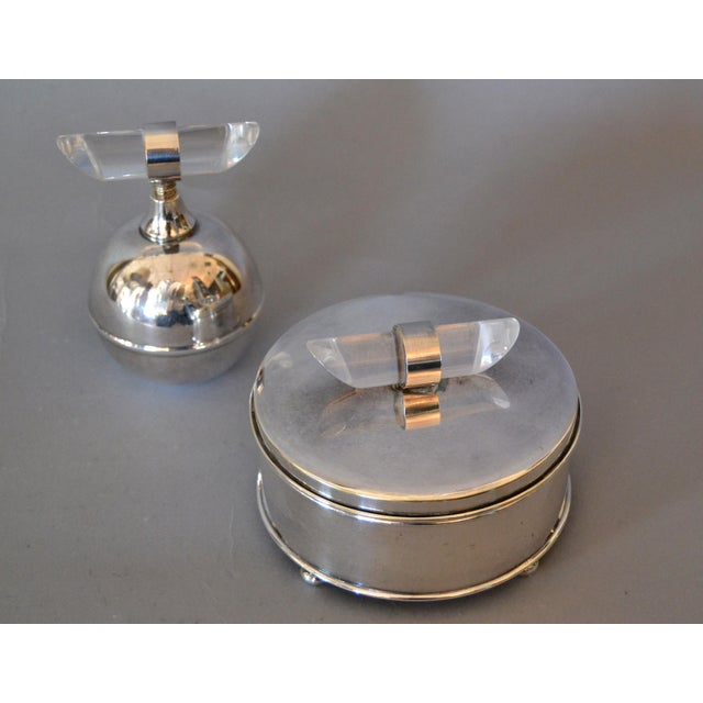 Elegant Mid-Century Modern Vanity Set comprising a Silver plated Perfume Bottle and a Glass bowl with Silver plated Powder...