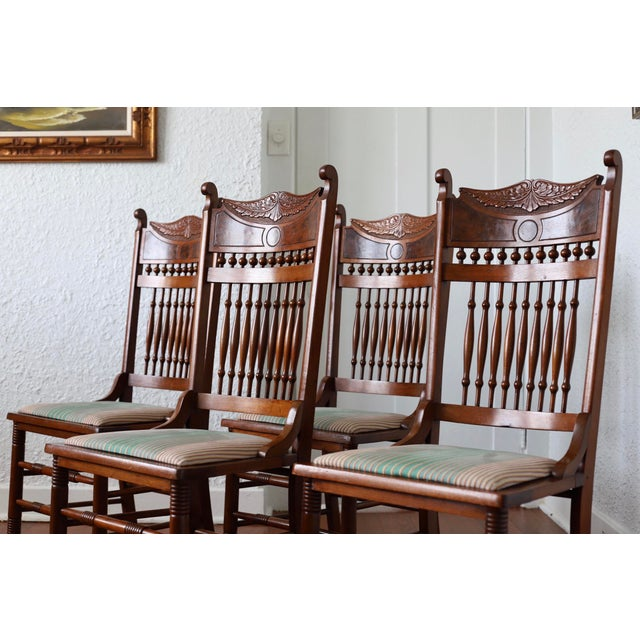 Set of four rare Stomps-Burkhardt walnut dining chairs from the early 1900s. Stomps-Burkhardt was a German-owned chair...
