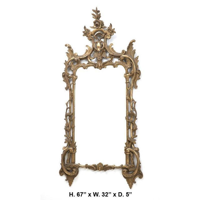 19th century Italian Baroque style carved giltwood mirror. The carved floral crest is over two C-scrolls with scrolling...