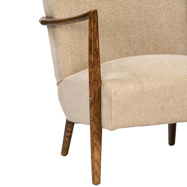 This stylish retro style arm chair has a solid hardwood frame made out of Oak. The beige color fabric is high quality...