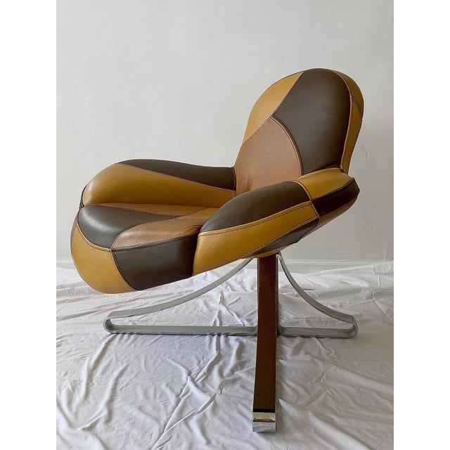 Postmodern lounge chair with tonal leather patchwork. Speaks Italian, body like a backroad & greets you with two kisses on...