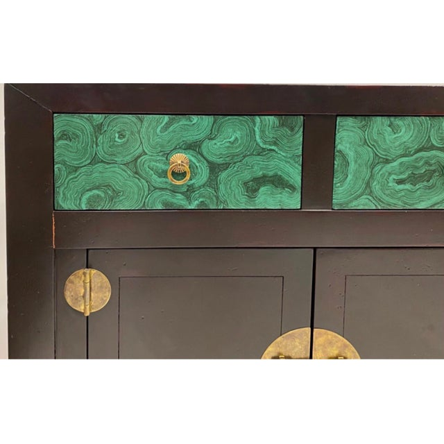 This is a large Asian style credenza by Henredon. It makes a bold statement with it's hand painted faux malachite drawer...