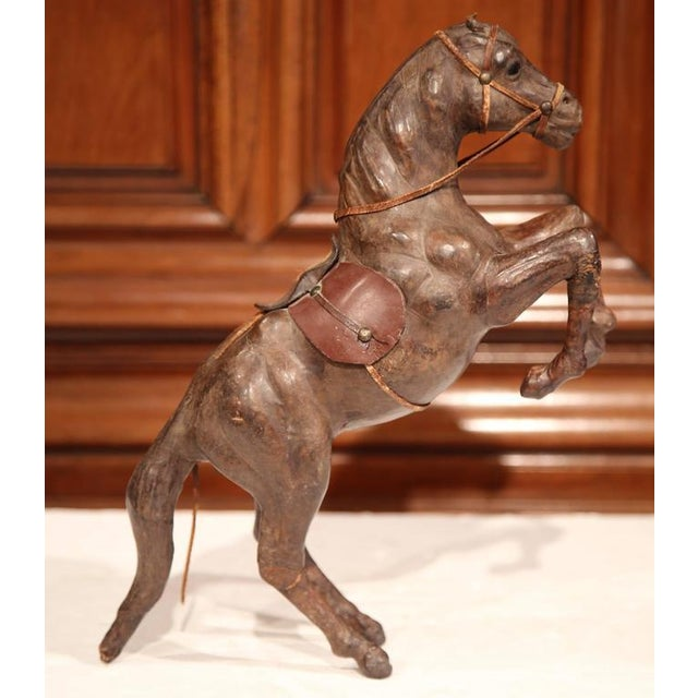 This beautiful, antique horse sculpture was crafted in France circa 1880. The rearing horse figure stands on his back legs...