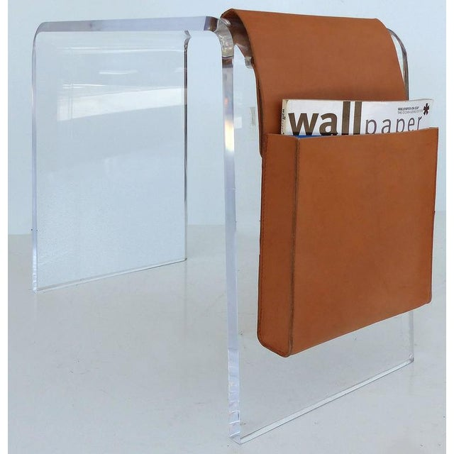 This is a substantial bent Lucite occasional table with a leather magazine pocket to one side. The piece could also be...