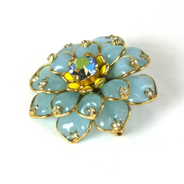 MWLC Pave Zinnia Brooch in pale aquamarine poured glass with crystal and aurora pave accents. One level of the flower...