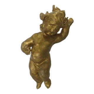 Gold Gilded Putti on Lucite Stand For Sale