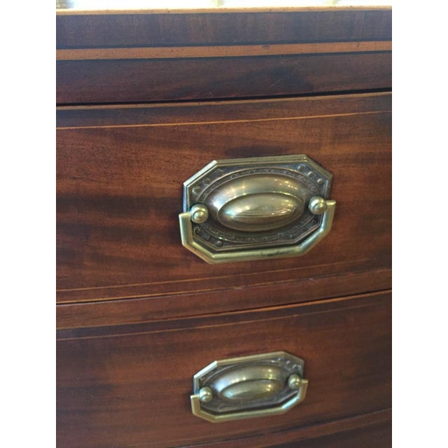 Lovely bowfront mahogany chest of drawers Subtle holly-wood inlay around top and drawers. Splay (french feet) add to the...