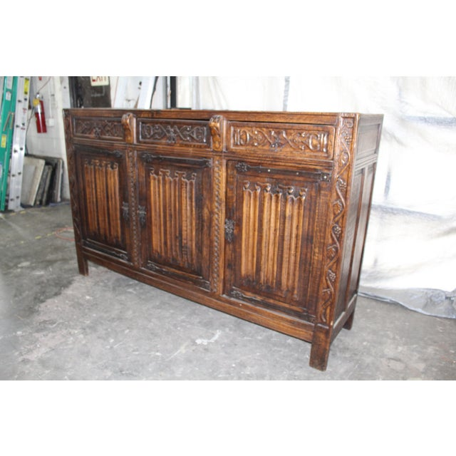 Beautiful French buffet/sideboard made of solid oak with three cabinets and corresponding drawers. This piece is rich with...