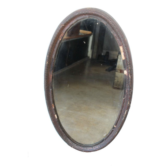 This gorgeous mirror will be the perfect wall accessory. Showing it's age in the patina and finish of the wood, it has...