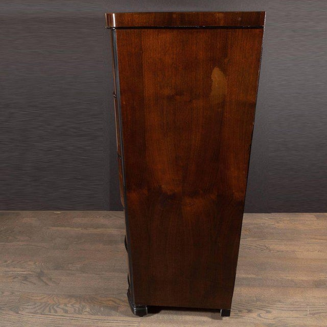 This refined high chest was realized by the Tri-Bond Furniture Company in the United States, circa 1935. It features five...