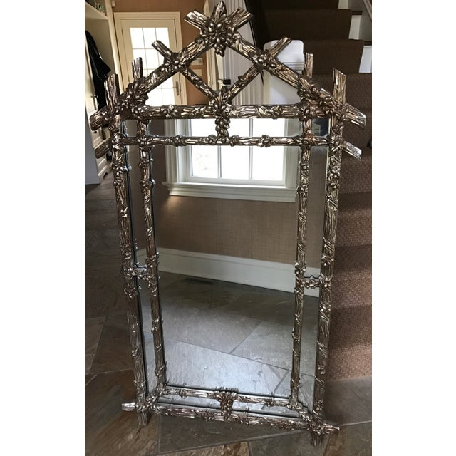 Offering a Gampel Stoll chinoiserie faux bois wall mirror in a silver metallic finish with copper color undertones. This...