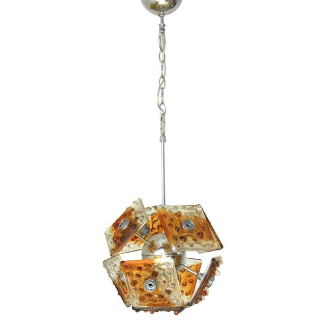 Vintage Italian pendant with clear and amber Murano glass tiles hand blown with bubbles within the glass, mounted on...