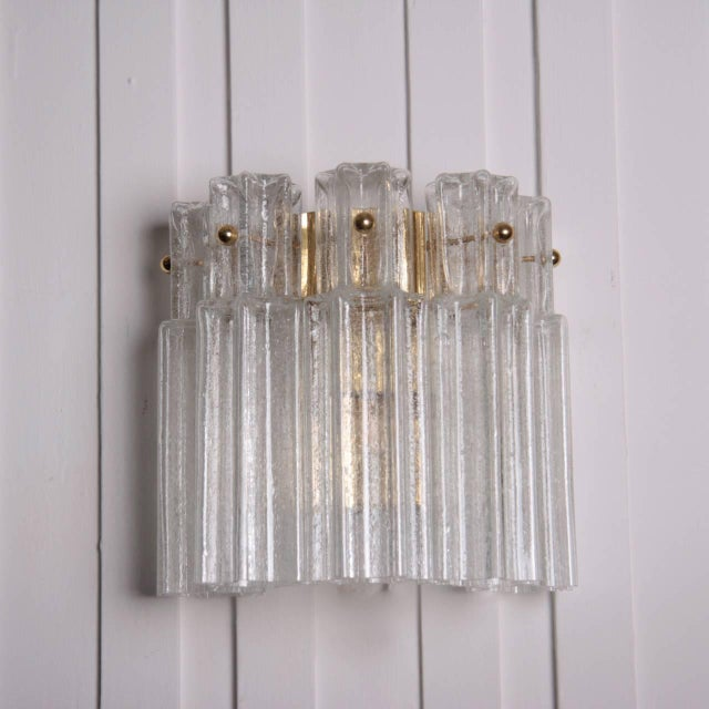 Rare Limburg sconces in brass and glass in excellent condition, in the Venini style. These lamps came out of a German...