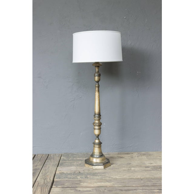 Silvered bronze floor lamp with patinated finish. Price includes polishing or plating and new wiring. Please allow 2 to 3...