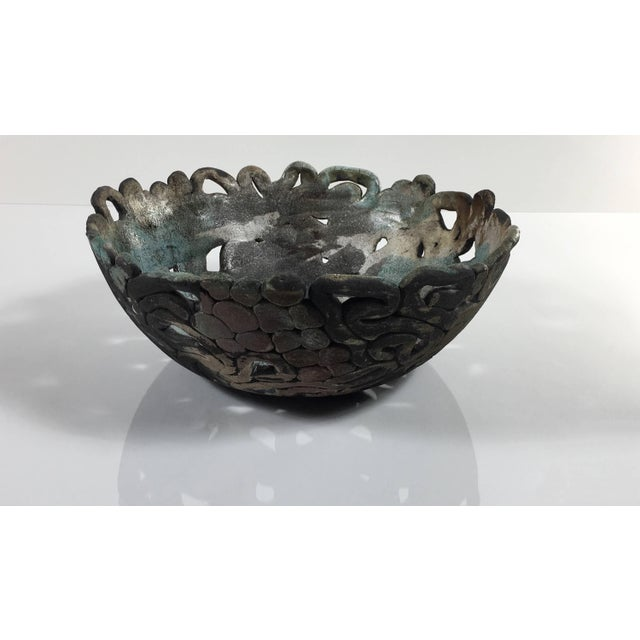 Unique abstract ceramic art sculpture/centerpiece bowl. Shaped from hand rolled coils and balls highlighting the negative...
