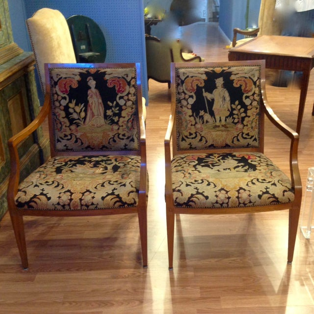 Fine fruitwood frames and dramatic original needlepoint seats and backrests. The seats are appointed with dragons and the...