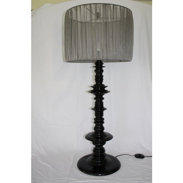 This is a large scale black lacquered turned wood lamp made by Noir. It has an inline switch and includes a sheer green...