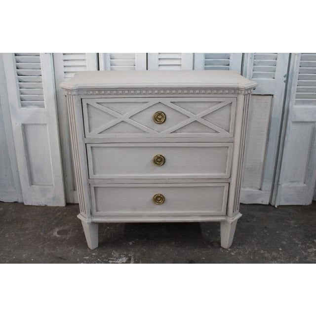 Vintage Gustavian nightstands made of solid oak and with three spacious drawers. Beautiful dentil molding and hand...