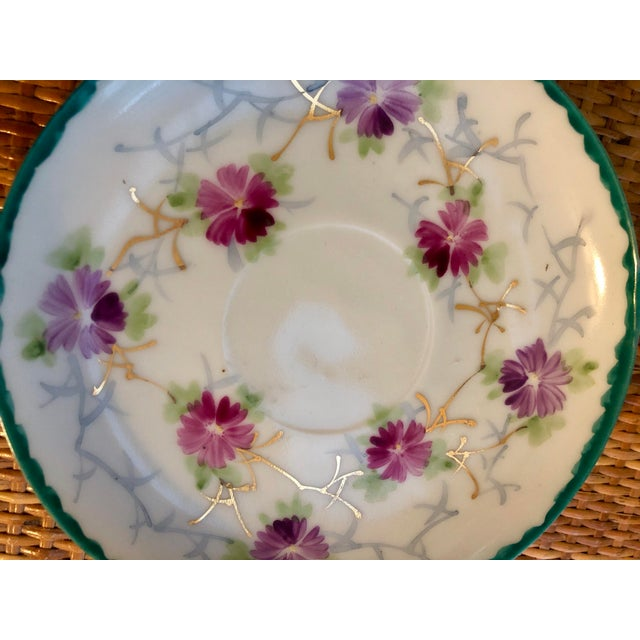 Adorable porcelain floral dish. Probably once served as a saucer, would serve as a precious soap or trinket dish!