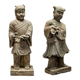 Pair of Stone Sculptures of Children at Play