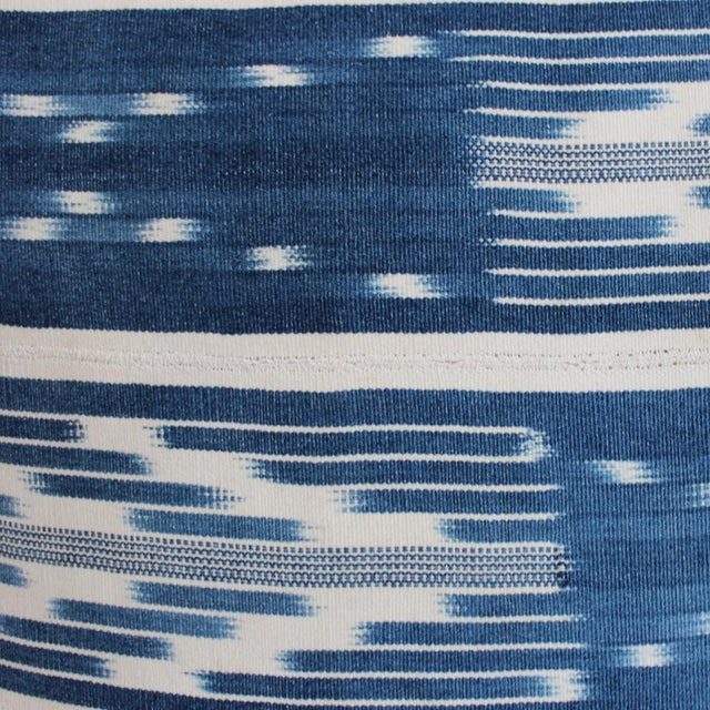 Blue and white Ikat patterned denim fabric pillow with down filling. This pillow is boho, chic, and unique!