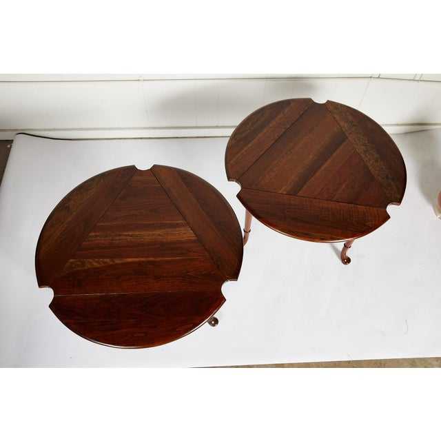 Pair of American vintage drop leaf tea or side tables in the Queen Anne style. The tables are made of solid cherry and...