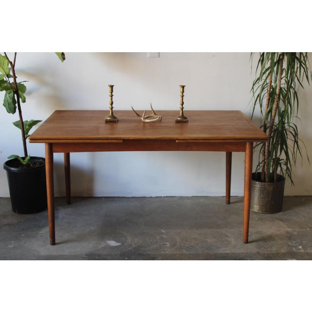 Danish teak 60's dining table with 2 extensions. Made in Denmark by G P Farum. In good vintage condition with light wear...