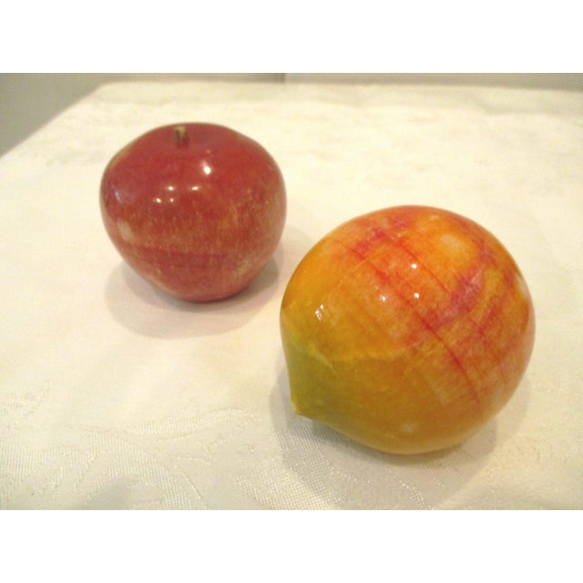 Colorful midcentury set of five carved and polished alabaster fruit consisting of one each of banana, apple, pear, peach...