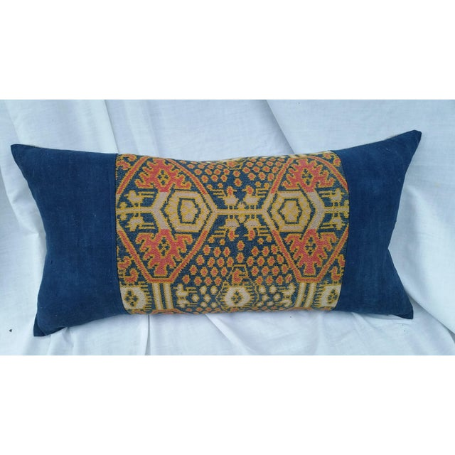 A tribal pillow made from a textile fragment woven by the Dong hill tribe people. Bordered with hand woven natural indigo...