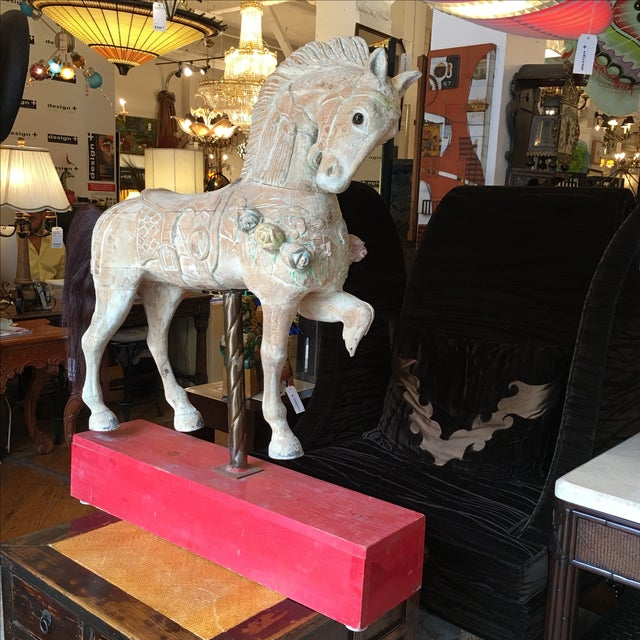 Antique wooden carousel horse. Once apart of a carousel that kept children and adults happy. A hand carved wooden beauty...