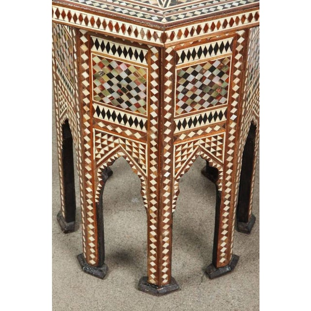 Syrian octagonal side table inlaid with mother-of-pearl, horn, ebony and camel bone. Moorish arches on the eight sides...