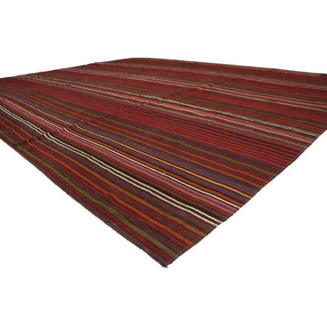 This is a modern style vintage Turkish jajim Kilim flat-weave rug. This handwoven wool piece features a variety of...