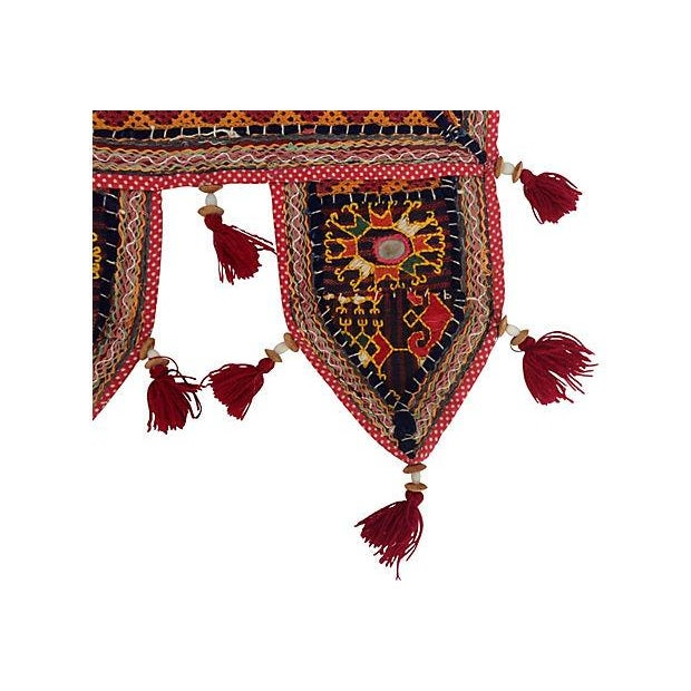 Antique embroidered mirrored door valance with tassels. Purchased in India.
