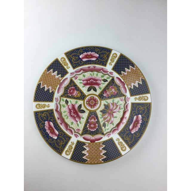 This is a beautiful English bone china set of 4 plates. The pieces are from the 1950s.