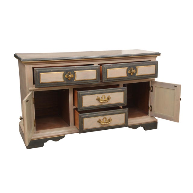 Chippendale style credenza made by American Drew. The case is taupe with brushed gold and distressed slate grey detailing....