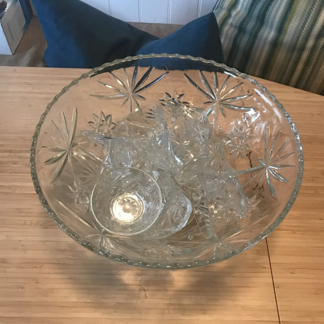 Amazing punch bowl set with starburst design. Made by Anchor Hocking in the 1960's this design was called Star Of David...