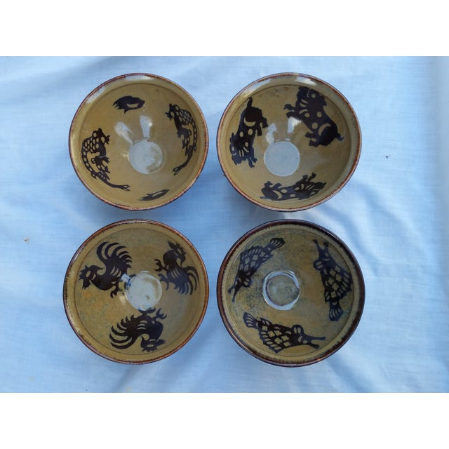 Set of four (4) wheel thrown pottery bowls with Chinese zodiac symbols. Bottom has vintage export seal. Made entirely by...