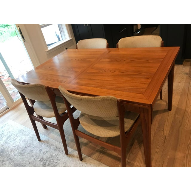 Vintage-modern dining set, beautiful teak drop-leaf dining table by Skovby Mobelfabrik and four upholstered O.D. Mobler...