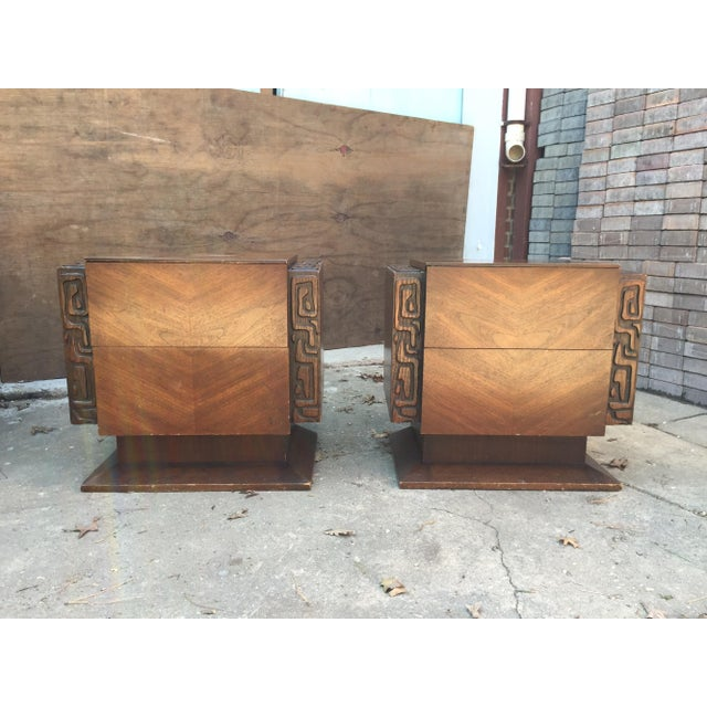 A pair of bedside tables manufactured by United Furniture Company. Dates to the 1970s. The bedside tables have two drawers...