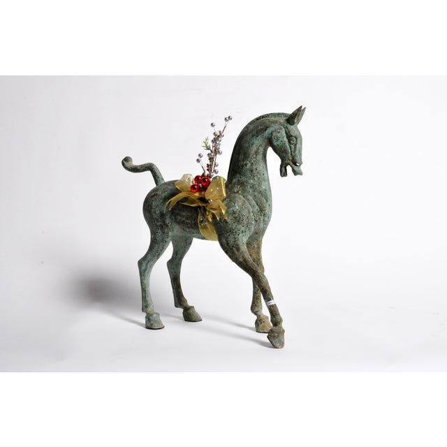 In ancient China, the horse was a symbol of power, freedom and virtue. This sculpture is based on ancient tomb bronzes...