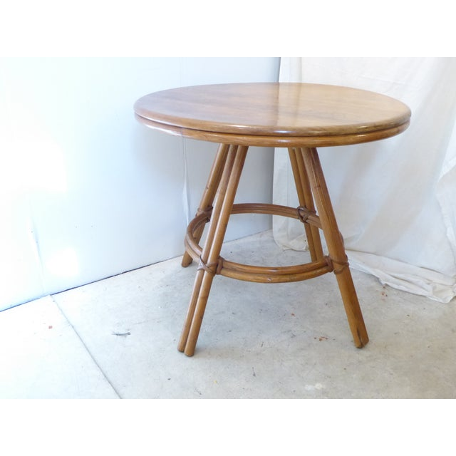 Round table with patinated top, bamboo legs, Heywood Wakefield stand on the underside, sturdy.