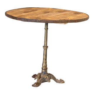 Vintage Round Bistro Table With Decorative Cast Iron Base For Sale