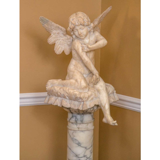 Figurative Alabaster Figure Winged Angel Sitting on a Pillow on an Alabaster Pedestal For Sale - Image 3 of 9