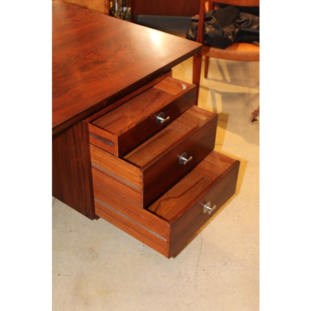 Stunning 1960s Danish rosewood technocrat executive desk designed by Finn Juhl for France & Son. with 5 drawers and chrome...