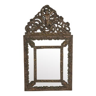 19th Century Spanish Colonial Brass Repousse Overly Mirror With Cherub For Sale