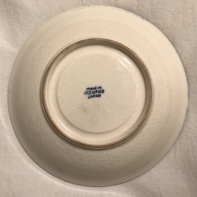 "Japanese ceramic saucer plate in ""Blue Willow"" pattern made circa 1940's as indicated by underside stamp ""Made in Occupied..."